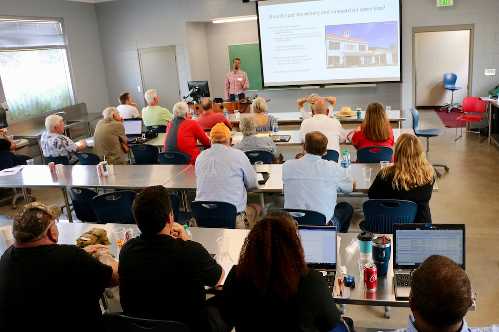 University of Georgia Cooperative Extension viticulture specialist goes over the basics of starting a muscadine vineyard at a muscadine workshop in Athens on July 9, 2019.