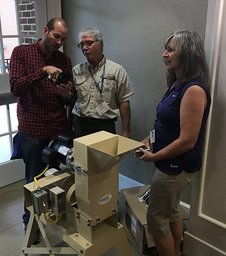 Frank Nolin and wife Lorna demonstrate a small-scale sheller he designed and built for peanut buyers in Malawi. The equipment also was interesting to researchers at the 51st annual American Peanut Research and Education Society meeting held in Auburn, Ala., July 9-11, 2019, because there aren't any small-scale shellers available to buy today.