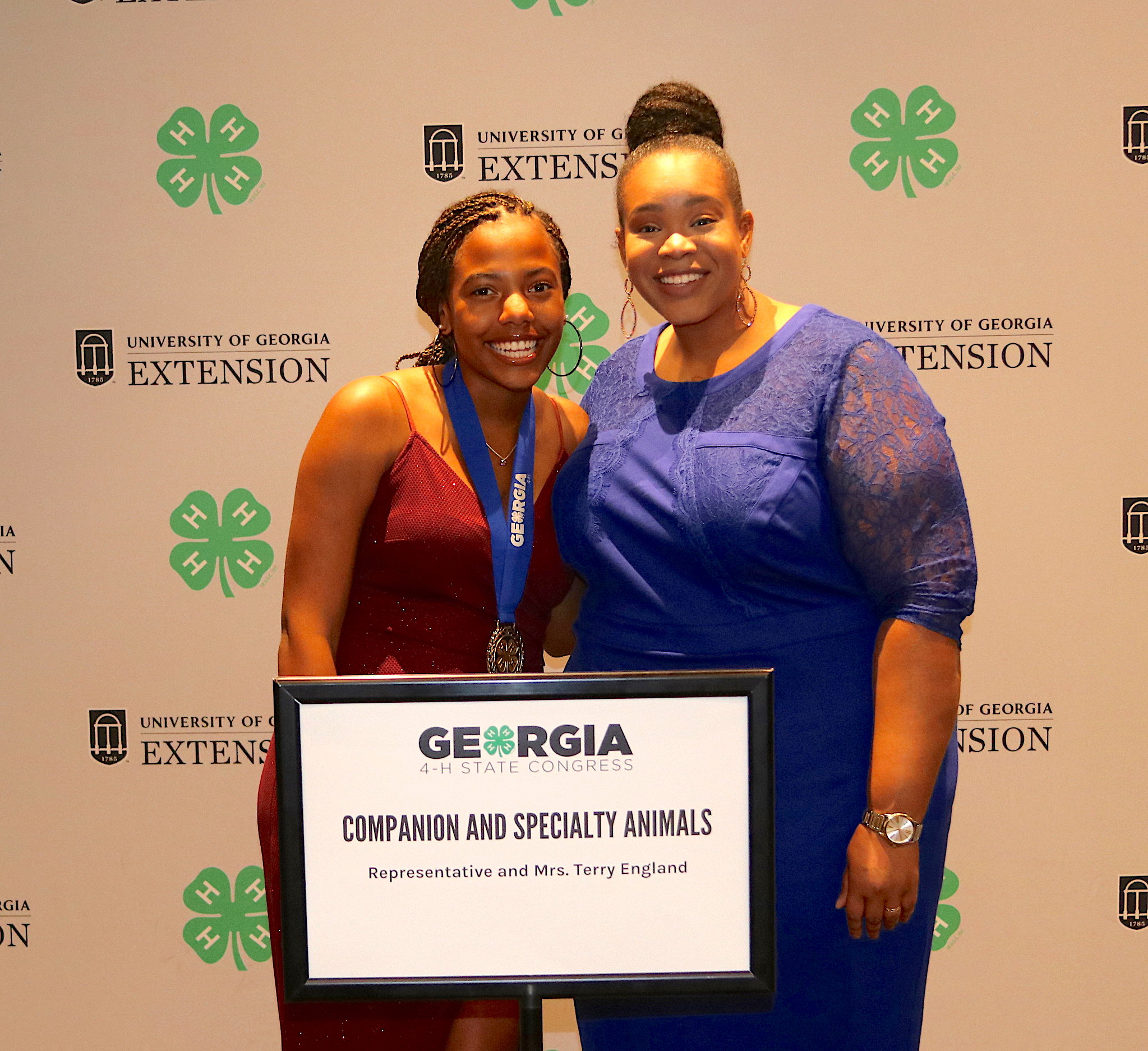 Georgia 4-H member Tandria Burke of Dougherty County was among the 4-H'ers who earned the title of Master 4-H'er during Georgia 4-H State Congress held July 23-26 in Atlanta. Burke competed in the Companion and Specialty Animals category. She is shown (left) with University of Georgia Cooperative Extension 4-H Agent for Dougherty County Jazmin Thomas.