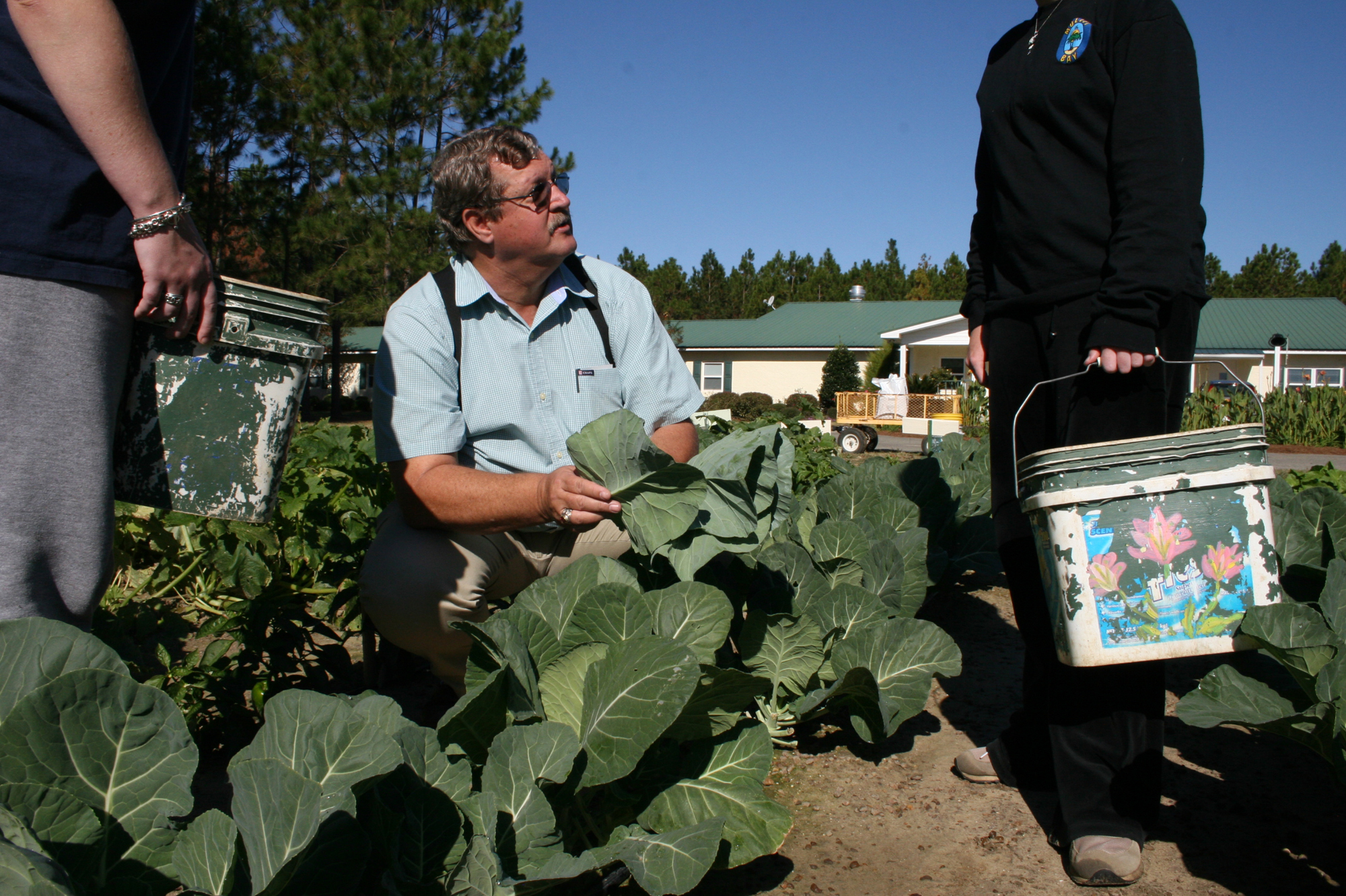 Johnny Whidden, Brooks County Extension coordinator, works on a vegetable garden with residents at Bridges of Hope residential alcohol and drug rehabilitation center.