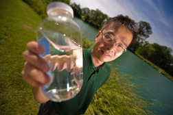 Jack Huang holds a jar of water for a research project on the UGA campus located in Griffin, GA.