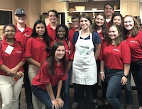 As part of a Georgia 4-H urban-rural student exchange program, 24 students toured across the state this summer to visit agricultural businesses. The One Georgia program students are shown with Georgia Grown Chef Olivia Rader (center in apron) during a tour of the Georgia Department of Agriculture.