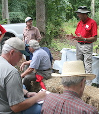 University of Georgia researcher Gary Burtle is shown teaching a group of landowners how to care for their ponds. Since 1987, Burtle has led workshops on aquaculture, water resources, fisheries, fish disease diagnostics, water quality and fish nutrition as a member of the UGA Animal and Dairy Science Department faculty.