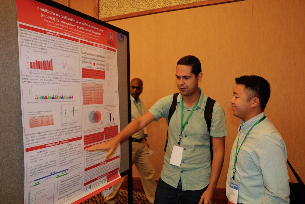 UGA graduate student Renan Souza presents his poster to one of the judges. More than 100 graduate students attended the 2019 National Association of Plant Breeders meeting.