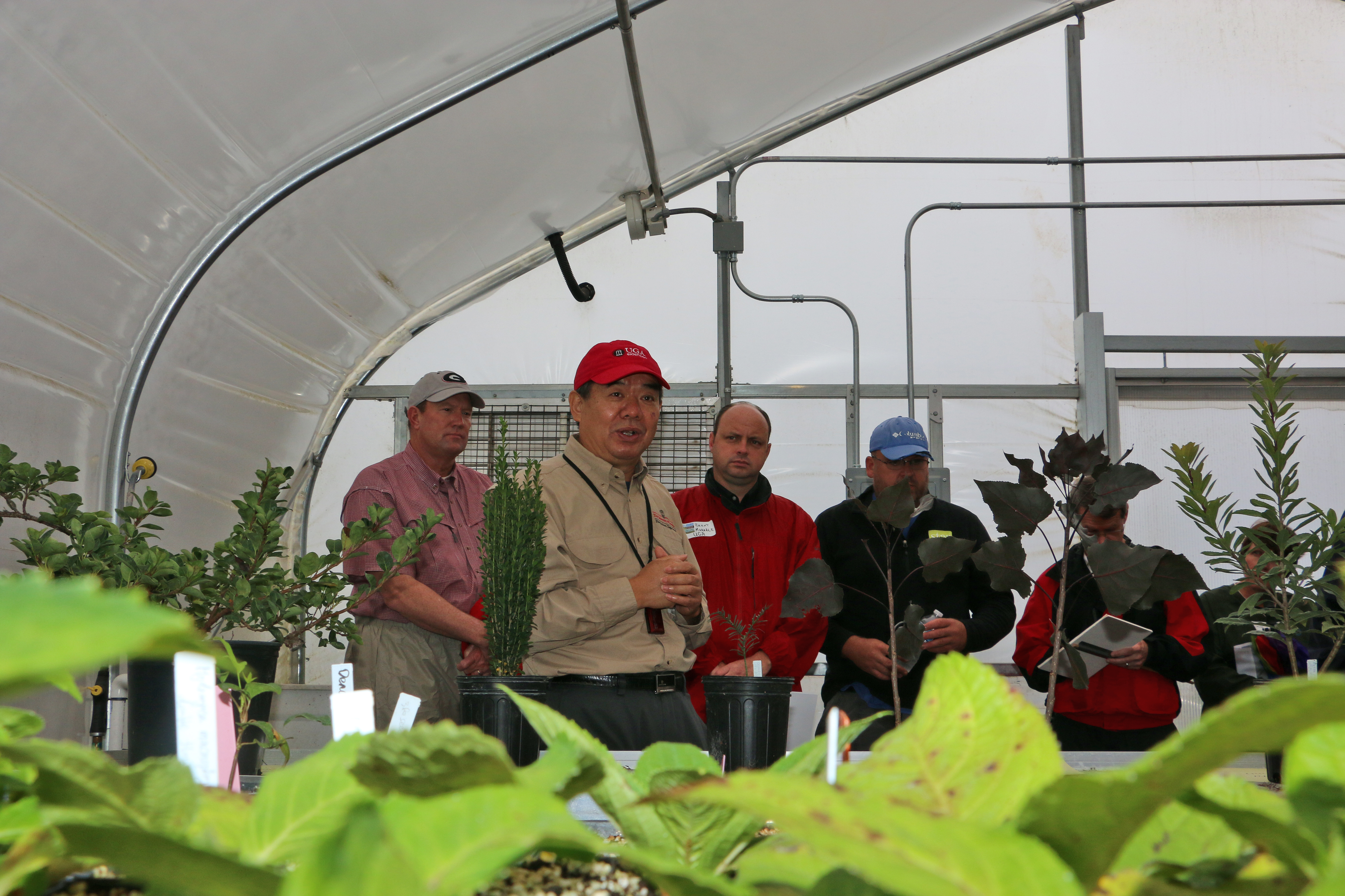 UGA horticulture Professor Donglin Zhang shows a group around his greenhouse at the Durham Horticulture Farm in Watkinsville during a past farm tour. The 2019 Horticulture Farm Tour will be held on Oct. 4 at 1221 Hog Mountain Road.