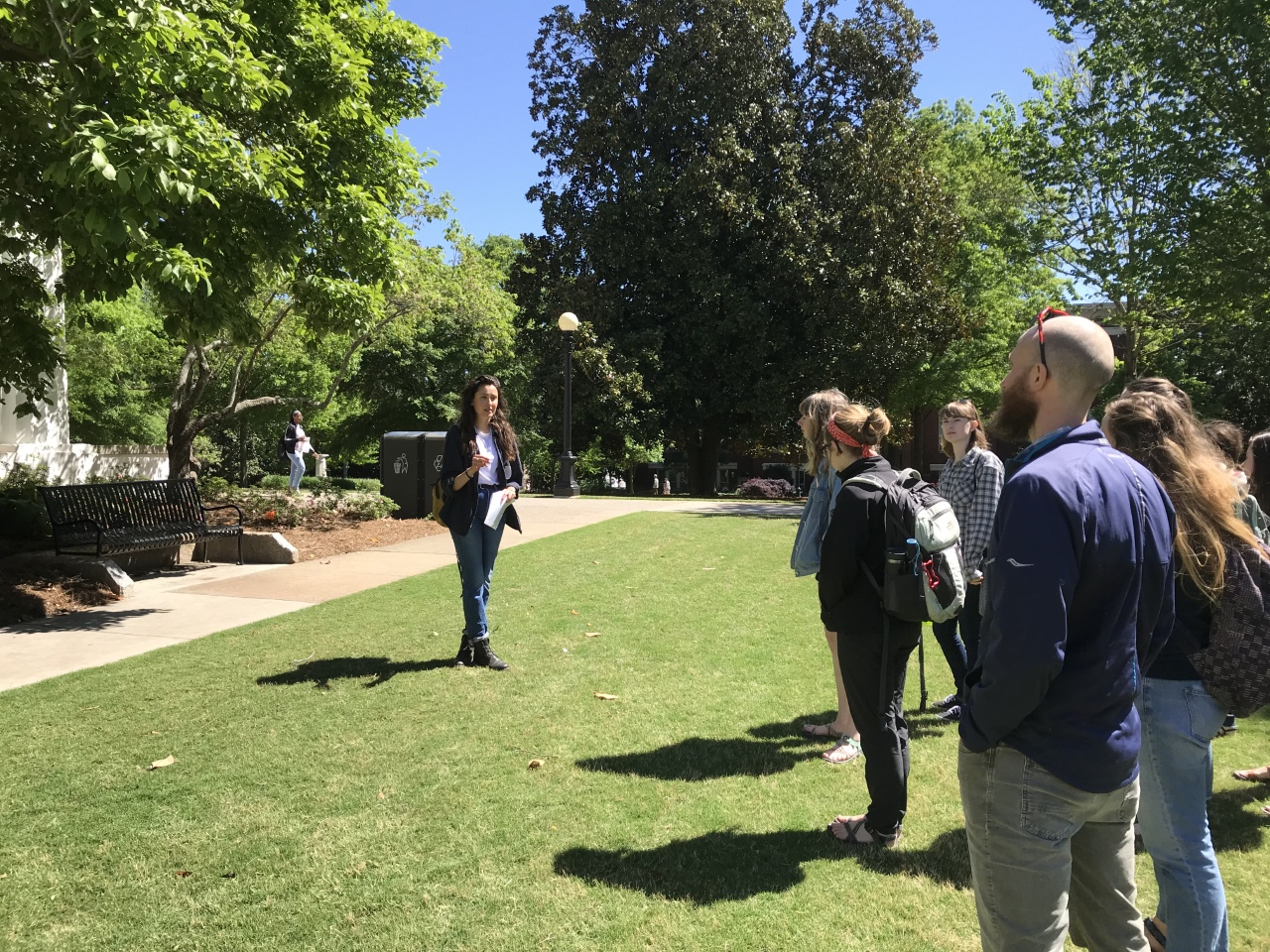 Kendall Busher, a CAES horticulture student at the UGA College of Agricultural and Environmental Sciences, leads a tour of the UGA Campus Arboretum, which is spread across campus. Busher created a web-based walking tour of the arboretum for the UGA Office of Sustainability.