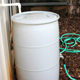 Frank Henning shows how a rain barrel can be used for irrigation. From small sizes like this one to larger harvesting systems, using rain water can save homeowners money and help the environment.