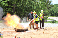 My PI Georgia training in Haralson County included practicing putting fires out.