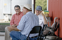 UGA President Jere W. Morehead and Georgia Commissioner of Agriculture Gary Black talk with Lee Cromley at Cromley Farms in Brooklet, Georgia.