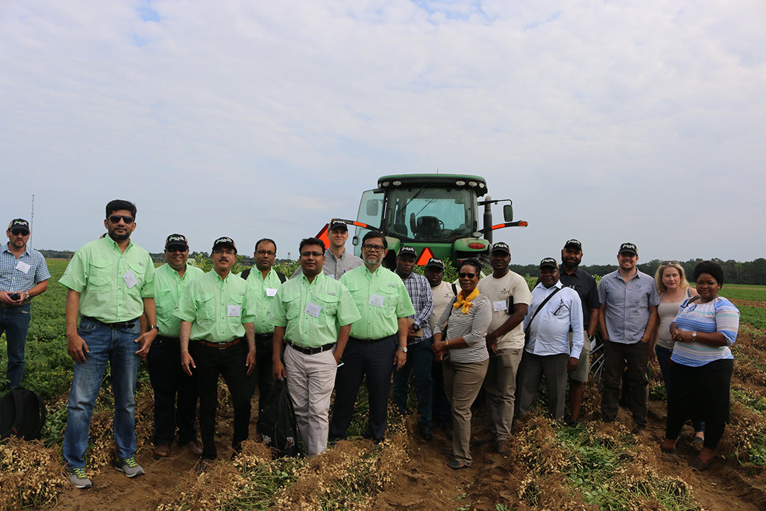 International visitors to the Georgia Peanut Tour pose on the Chase family farm near Oglethorpe, Ga., in September 2019. The Feed the Future Peanut Innovation Lab at the University of Georgia has facilitated visits from international partners for several years. (Photo by Allison Floyd)