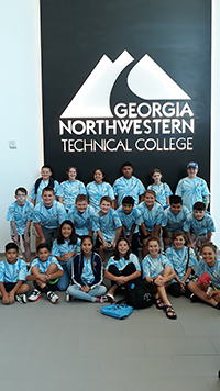 4-H'ers pose for a photo in the Life 101 conference held in north Georgia in 2019. Front; from left, Justin Murrillo, Carlos Perez, Maria Perez, Emily Nunez, Sara Wood, Savannah Griffin, Casey Page; middle row, from left, A.J. Reid, Colton Jones, Walker Jones, Jacob Lea, Garv Patel, Meah Hobbs, Danny Angeles, Collin Devlin; back row, from left, Ethan Hooker, Angelina Galvin, Adrianna Hernandez, Kevin Murrillo, Ashlyn Williams and Gabe Blackburn.