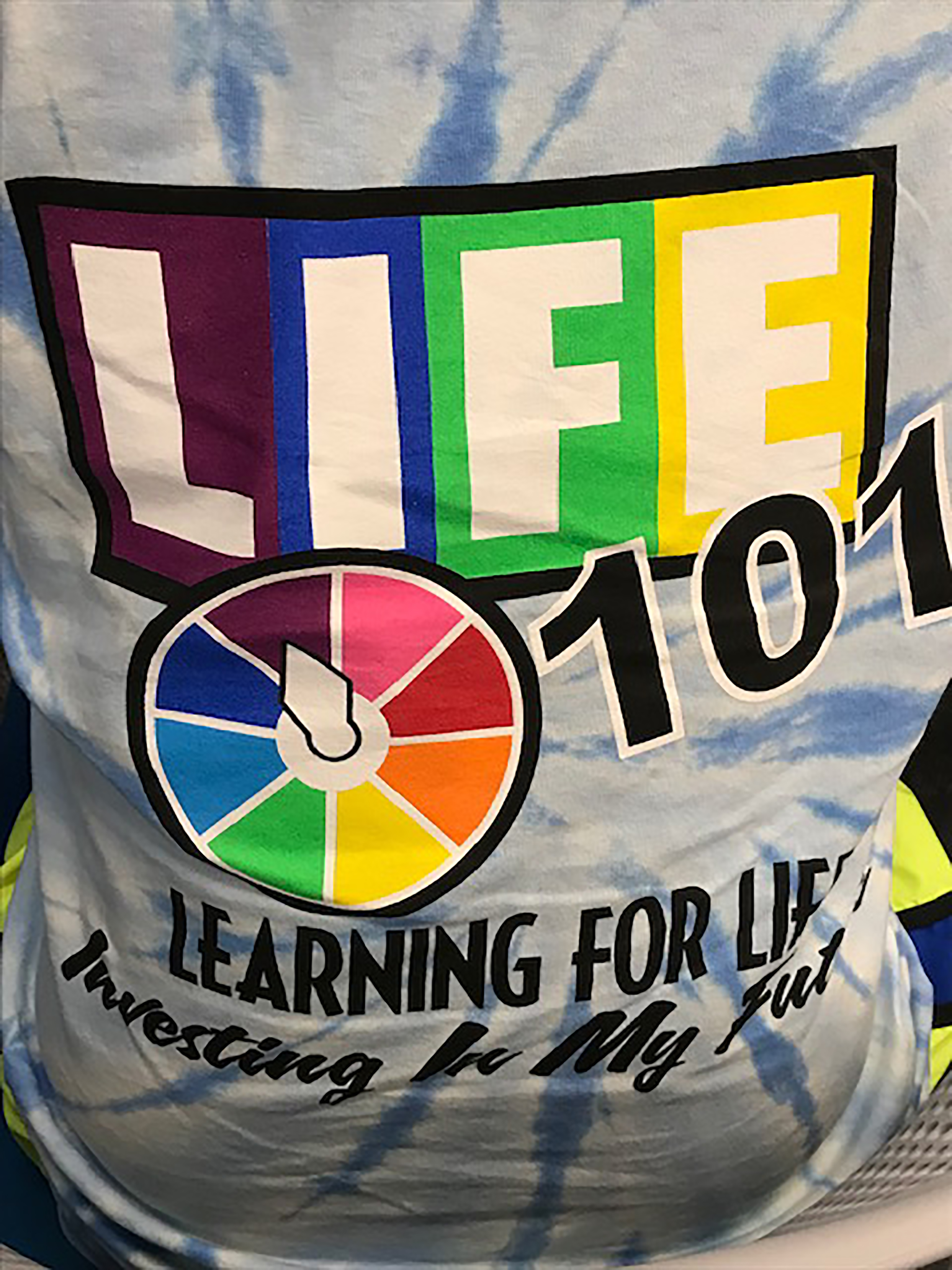 "Shirt design for the Life 101 Conference in 2019 resembles the classic game ""Life."""