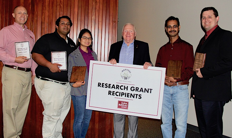 Georgia Farm Bureau President Gerald Long (center) announced the recipients of the GFB Harvest 20 Research Grants at the GFB Commodity Conference on Aug. 8. University of Georgia faculty who were awarded grants are (l-r) Lawton Stewart, Govindaraj Dev Kumar, Angelita Acebes, Sudeep Bag, Jonathan Oliver and (not pictured) Bhabesh Dutta and Mark Freeman.