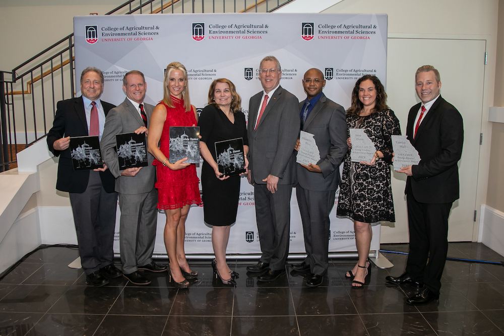 UGA CAES Dean Sam Pardue, center, congratulates CAES alumni Ken Foster, Charlie Broussard, Jaime Hinsdale Foster, Andrea B. Simao, Franklin West, Sarah Dunn and Tamlin Hall during the 65th CAES Alumni Association Awards Banquet on Oct. 4 in Athens, Georgia.