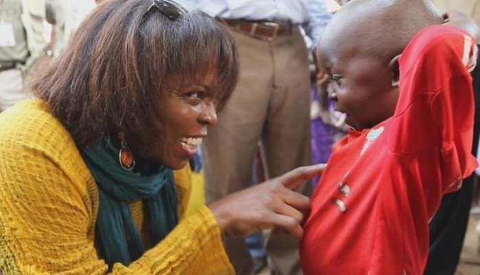 The former executive director of the United Nations World Food Programme, Ertharin Cousin, talks to a boy in the Central African Republic during her visit in late March 2014. Photo by World Food Prize. Not for reuse.
