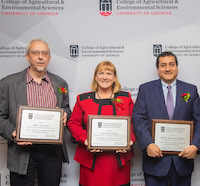 D.W. Brooks Award of Excellence winners Marc van Iersel, Vincent J. Dooley Professor of Horticulture; Lori Purcell Bledsoe, Georgia 4-H program development coordinator for Northeast Georgia; and Alfredo Martinez-Espinoza, professor of plant pathology, are congratulated by CAES Dean and Director Sam Pardue.