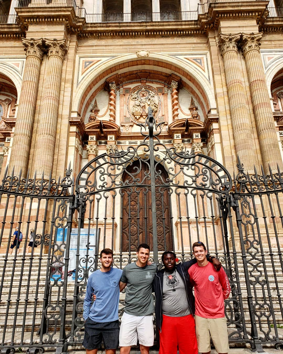 College of Agricultural and Environmental Sciences students Chad Cain, Sam Bignault, Joshua Toran and Logan Waldrop pose in front of a cathedral in Malaga, Spain, during the Spain: Food Production, Culture and the Environment study abroad program in 2019.