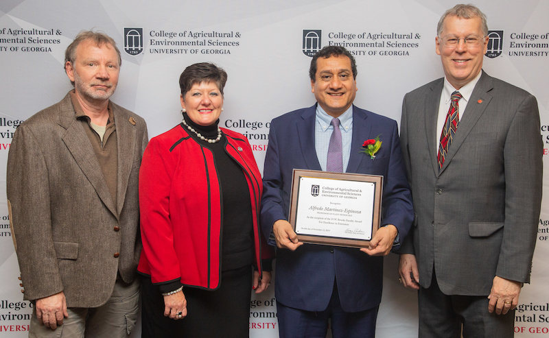 UGA plant pathologist Alfredo Martinez-Espinoza was recently awarded the D.W. Brooks Award for Excellence in Extension. He is shown (second from right) being congratulated by (left to right) Harald Scherm, head of the UGA Department of Plant Pathology, Laura Perry Johnson, UGA Extension associate dean, and Sam Pardue, dean of the UGA College of Agricultural and Environmental Sciences.
