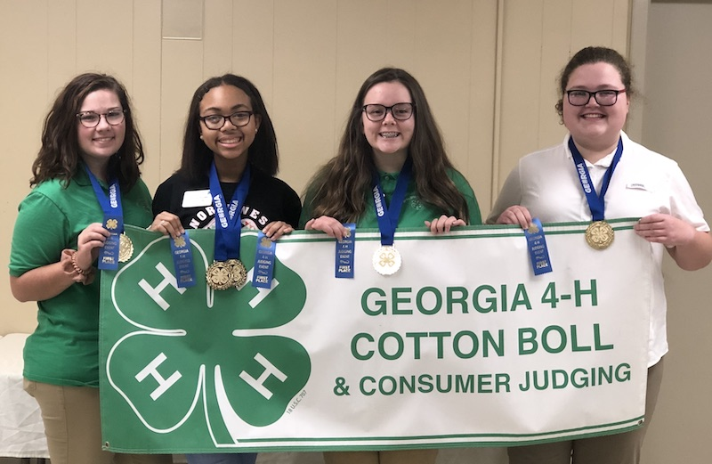 The Cotton Boll and Consumer Judging Competition is part of the Georgia 4-H Healthy Living Program. This competitive judging contest teaches 4-H'ers about cotton as an agricultural commodity in Georgia as well as cotton promotion through commercials or advertisements. The Spalding County team won first place and High Overall Individual went to Jahycee Barnes. Pictured left to right are Shelby Lane, Barnes, Kaylee Collins and Heather Dorn.