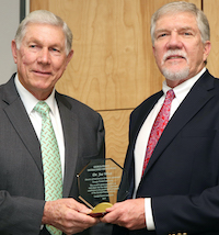 Armond Morris, chairman of the Georgia Peanut Commission, is shown (left) presenting the Distinguished Service Award to Joe West, assistant dean of the University of Georgia Tifton campus.