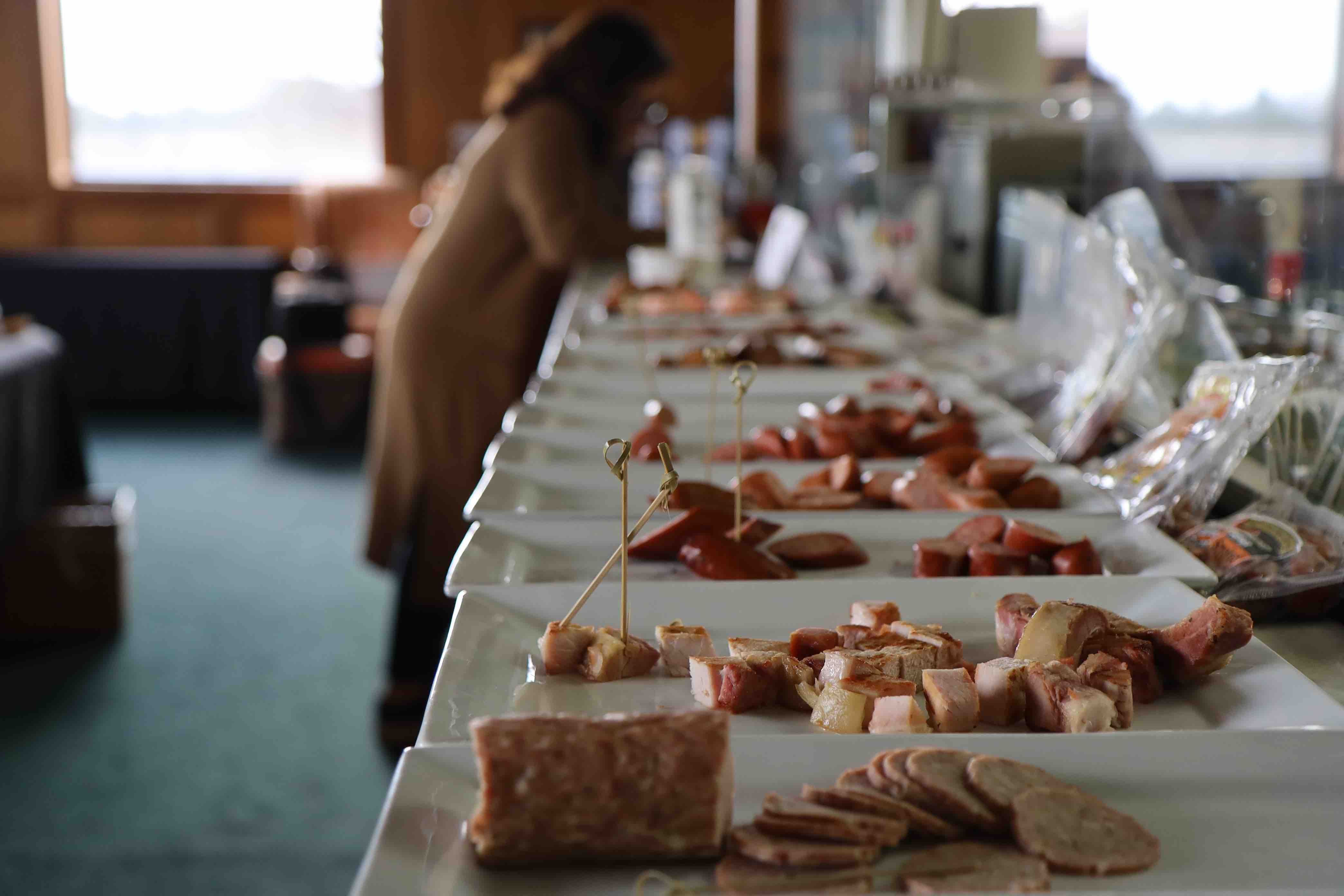 Meat and seafood products are prepared for judges to sample during the first round UGA's Flavor of Georgia Food Product Contest.