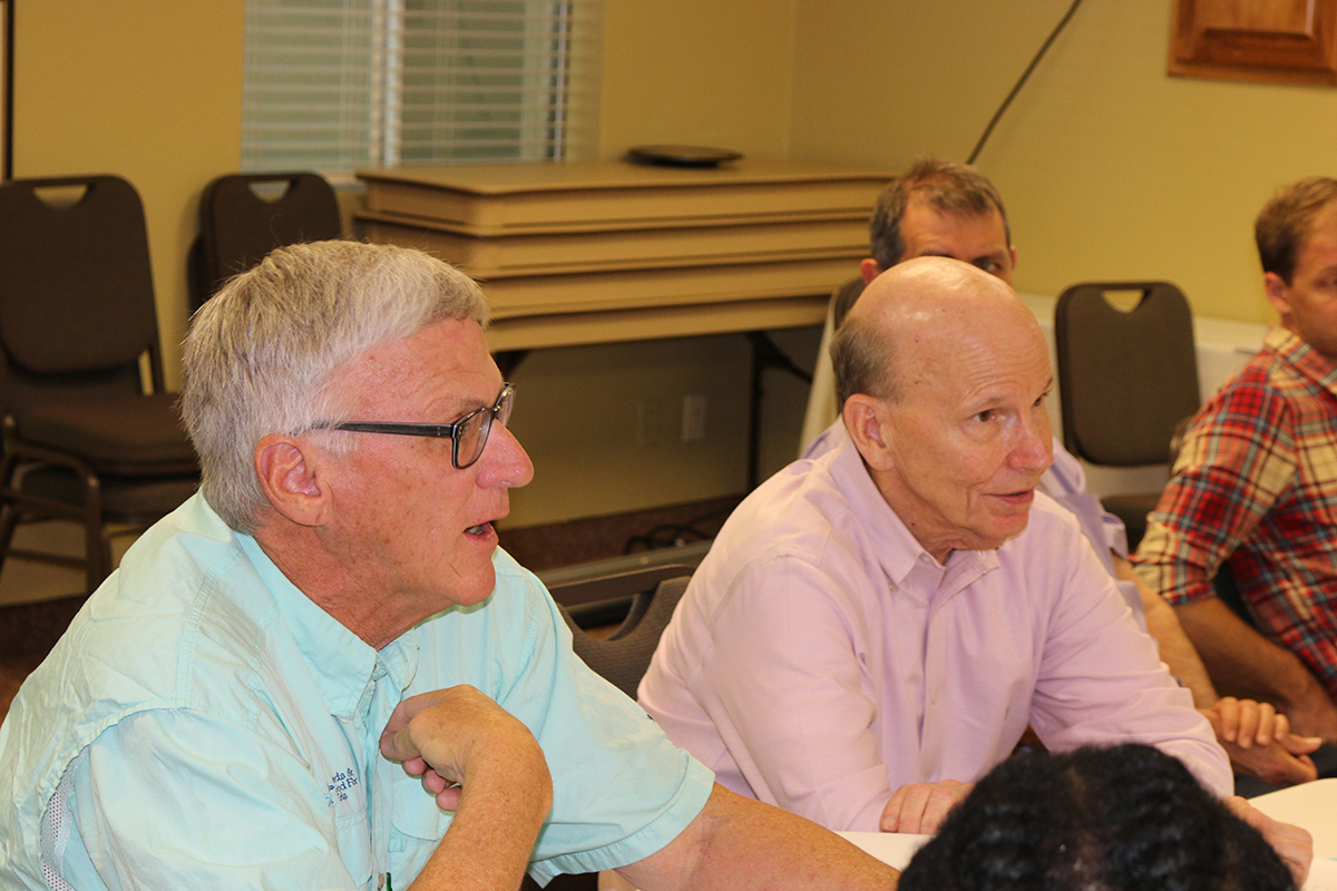 Steve Brown (left), executive director of the Peanut Research Foundation, and Jeff Johnson, a retired Birdsong Peanuts executive who serves on the Peanut Innovation Lab's External Advisory Panel, discuss project proposals as the lab started a new five-year program in 2018. (Photo by Allison Floyd)