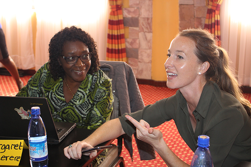 Margaret Mangheni, a professor at Makerere University and leader of Gender-Responsive Researchers Equipped for Agricultural Transformation, and Jessica Marter Kenyon, a post-doctoral fellow with the Peanut Innovation Lab headquartered at the University of Georgia, chat at a recent training in Kampala, Uganda. The training for students and scientists working with the lab in southern and eastern Africa was conducted March 10-12 by GREAT, a partnership by Makerere and Cornell University to show agricultural researchers the impact gender considerations have on their studies.