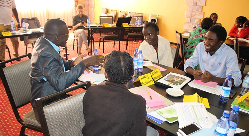 Participants work through an activity at training held by the Peanut Innovation Lab through Gender-Responsive Researchers Equipped for Agricultural Transformation in Kampala, Uganda. The training for students and scientists working with the lab in southern and eastern Africa was conducted March 10-12 by GREAT, a partnership by Makerere and Cornell University to show agricultural researchers the impact gender considerations have on their studies.