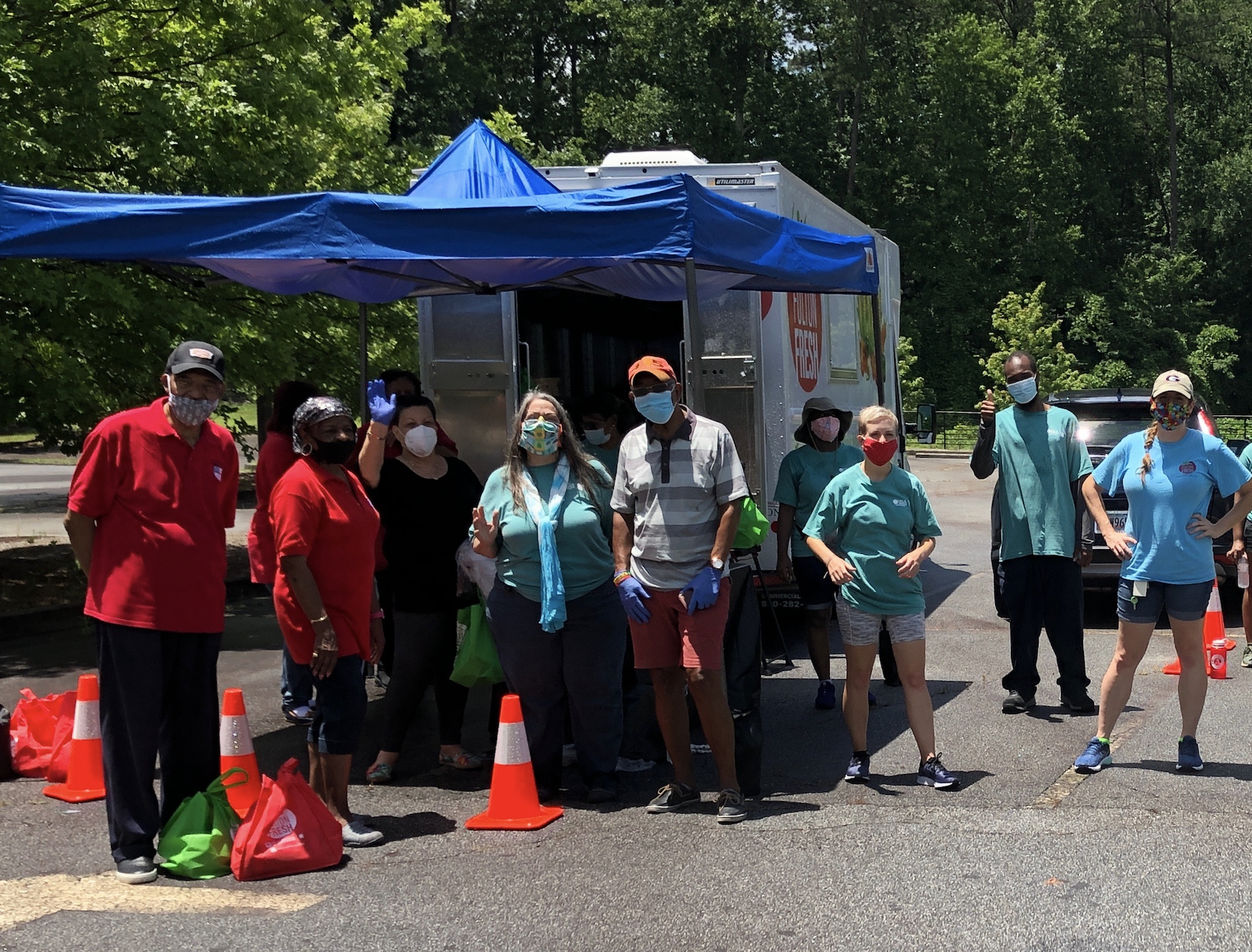 Fulton County Extension staff and volunteers prepare to distribute produce bags through curbside pickup at a Fulton Fresh mobile market stop in Atlanta. (Photo by Molly Woo)