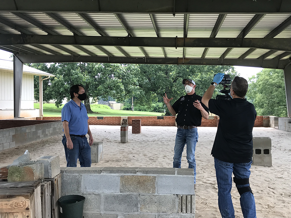 "UGA entomologist Dan Suiter (left) films a segment for Georgia Farm Monitor with Nick ""Ranger Nick"" Fuhrman and cameraman Ray D'Alessio."