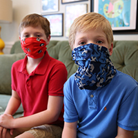 Child development specialist Diane Bales recommends parents practice putting on and wearing masks with their kids before in-person classes resume.