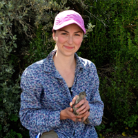 UGA entomology fellow Olivia Smith posing with a bird during her food safety and wildlife conservation research.