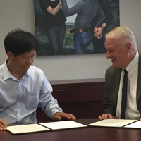 UGA Animal and Dairy Science Department Head Francis L. Fluharty (right) and Dengpan Bu, professor of animal nutrition in the Institute of Animal Science of the Chinese Academy of Agricultural Sciences, met to discuss ideas for collaboration and sign an MOU two years ago. The departments hope to expand the relationship to include undergraduate and graduate student exchanges. (file photo)