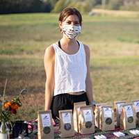 Erica Head, a student in the Organic Horticulture Entrepreneurship class and student assistant herb manager at UGArden, sells teas from herbs she's grown and processed at a weekly student farmers market.