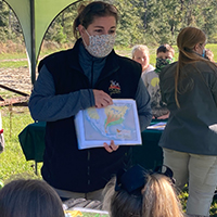 Jessica McGuire, with the nonprofit conservation organization Quail Forever, teaches students about wildlife conservation at Shiver Elementary School, where Grady County 4-H'ers planted a pollinator garden to help students understand the importance of protecting ecosystems.