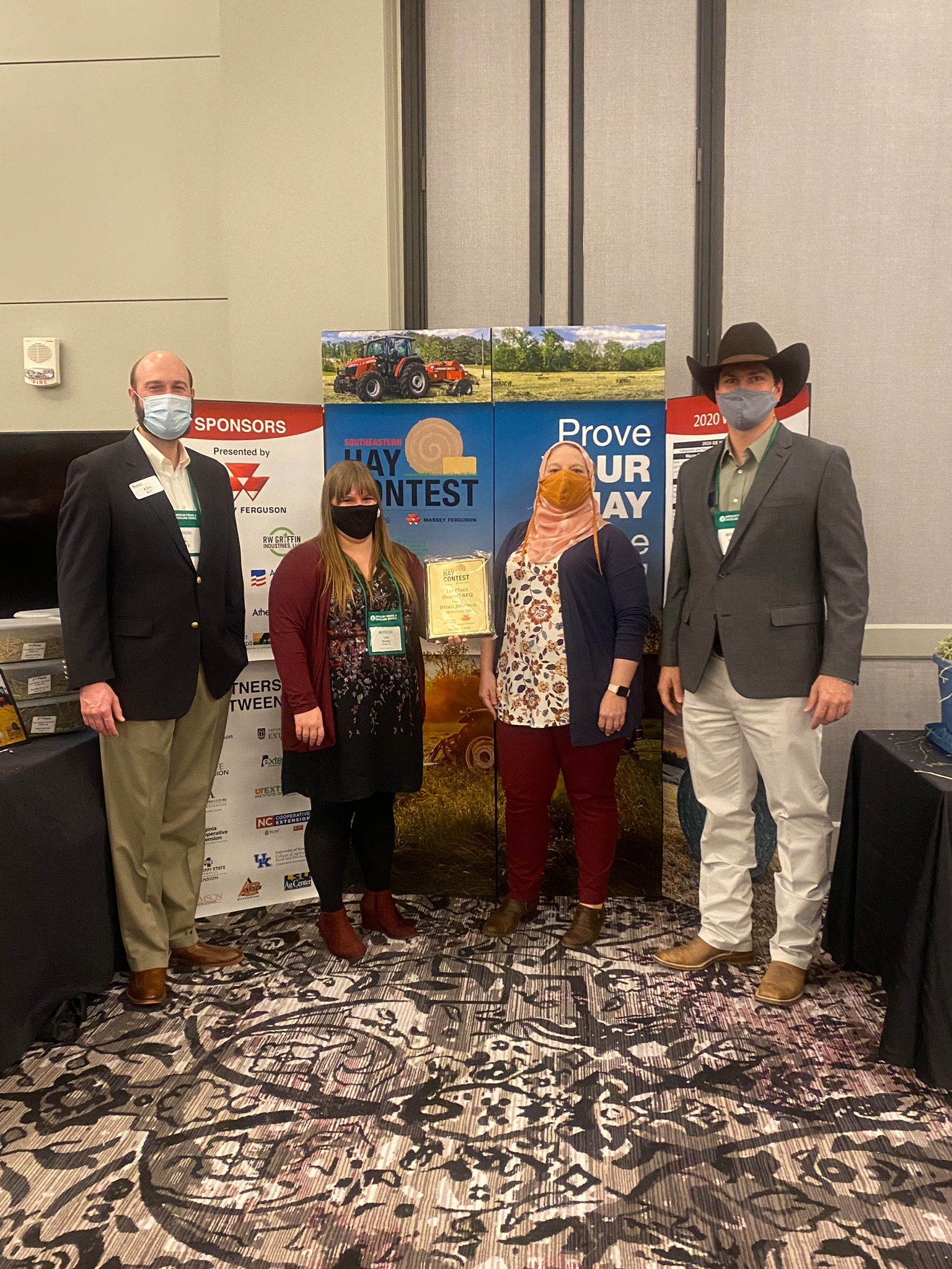 The 2020 Southeastern Hay Contest grand prize was awarded to Brian Johnson of McKenney, Virginia, for his alfalfa hay sample (not pictured). Pictured from left to right are Ash Alt, Massey Ferguson Field Execution Manager; Lisa Baxter, UGA Forage Extension Specialist; Leanne Dillard, Auburn University Forage Extension Specialist; and Marcelo Wallau, UF Forage Extension Specialist.