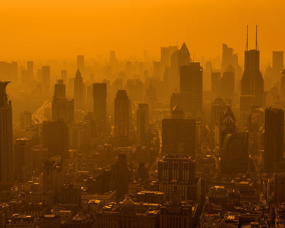 The Shanghai skyline is often clouded with smog from industrial air pollution.