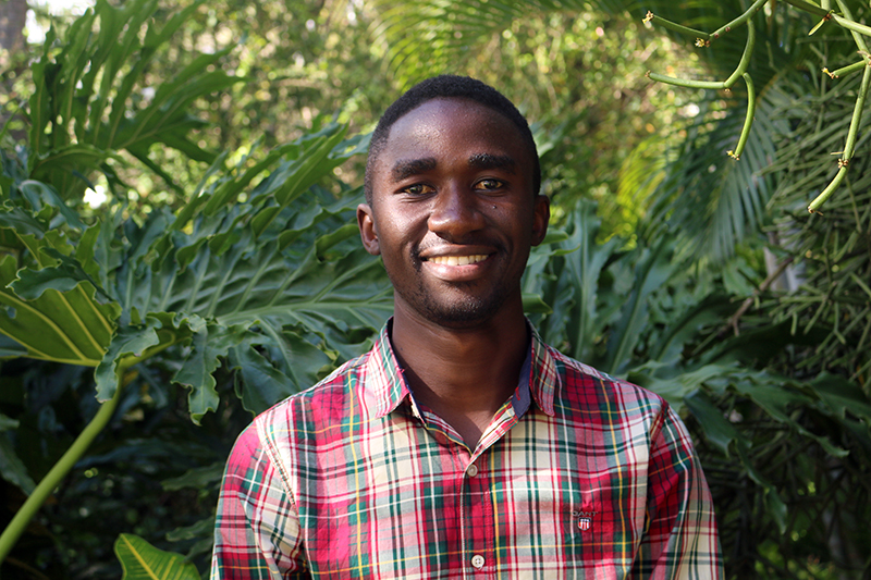 Ivan Chapu has worked with hand-held sensors in groundnut test plots in Uganda as past of a three-country project to use the technology for high-throughput phenotyping. Now that he's completeing a master's degree from Makerere University, he hopes to continue on to a PhD. (Photo by Allison Floyd)