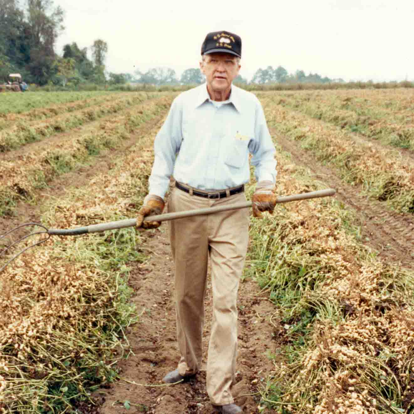 "Known as ""Mr. Peanut,"" Frank McGill spent the majority of his career working at the University of Georgia Tifton Campus as an Extension peanut specialist. He is pictured here with a high peanut yield in 1974."
