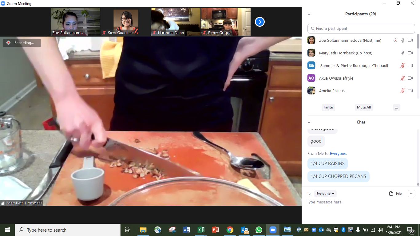 MaryBeth Hornbeck, Family and Consumer Sciences and 4-H Extension agent, chops pecans in a demonstration for the virtual cooking club.