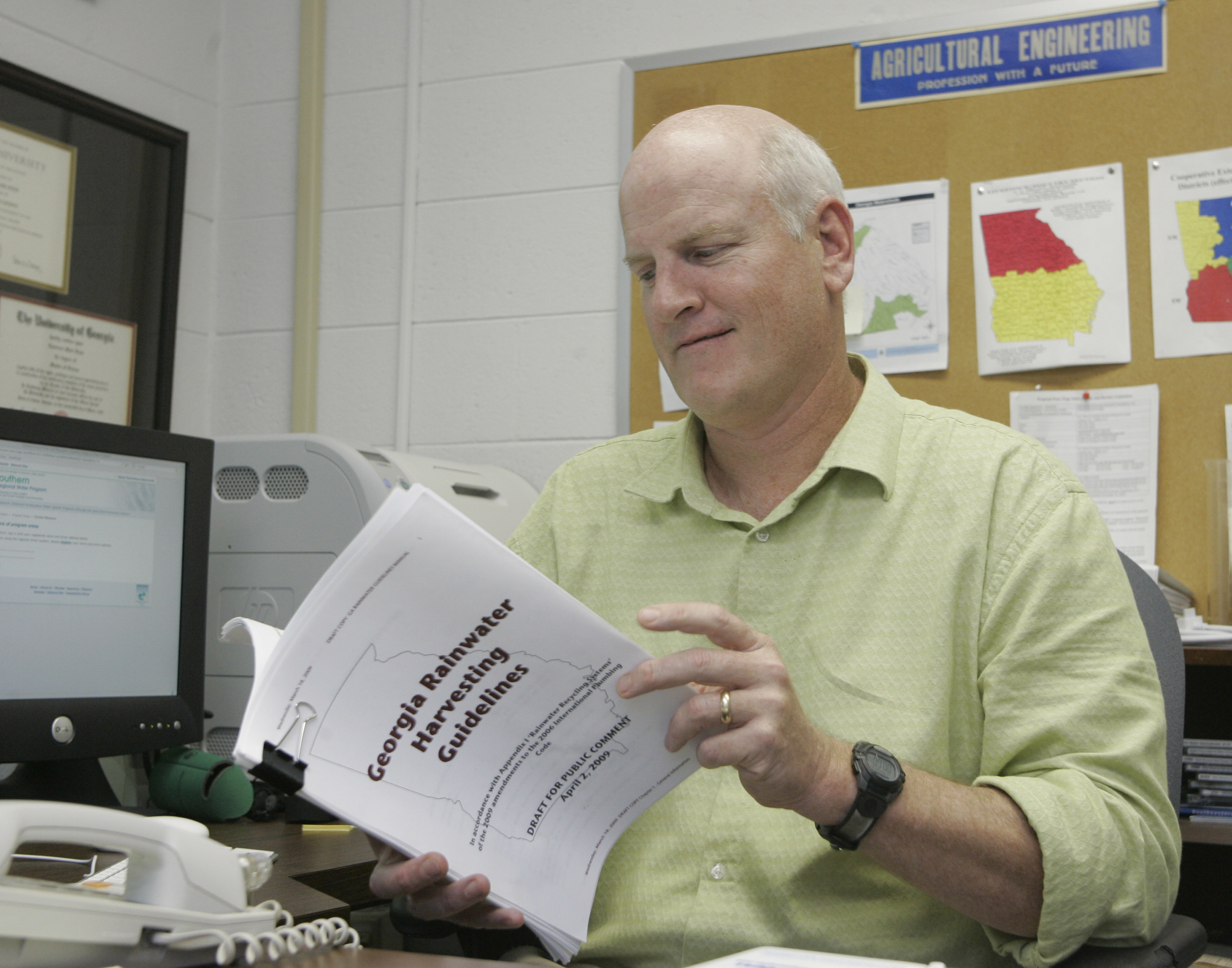 Mark Risse checks out a draft of the Georgia Rainwater Harvesting Guidelines. Risse is a University of Georgia Cooperative Extension engineer with the College of Agricultural and Environmental Sciences.