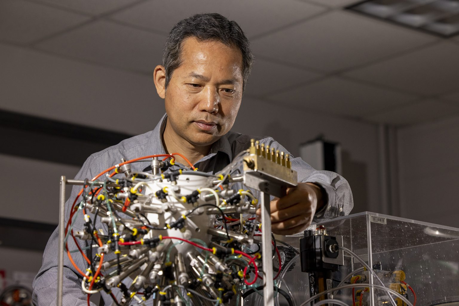 Fanbin Kong, professor of food engineering at UGA's Department of Food Science and Technology, works to build artificial gastrointestinal systems and study the digestion of food and nonfood materials. (Photo by Dorothy Kozlowski/UGA)