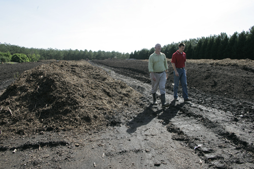 Mark Risse, left, and Adam Speir check out the compost piles at the University of Georgia. Risse and Speir are faculty in the UGA College of Agricultural and Environmental Sciences Department of Biological and Agricultural Engineering.