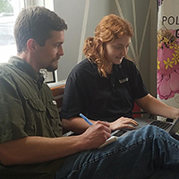 David Buckler works with Catoosa County 4-H'er Emily Momberg as part of the 4-H Tech Changemakers project to address the digital divide by providing education on common technological devices, assisting with one-on-one support, and helping with online activities. (Photo taken prior to 2020)