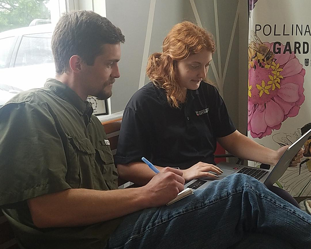 David Buckler works with Catoosa County 4-H'er Emily Momberg as part of the 4-H Tech Changemakers project.