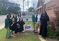 Georgia 4-H'ers and well wishers pose with Willie Spence gear near the Coffee County 4-H office in support of Spence, former 4-H'er and 2021 American Idol runner-up, on Willie Spence Day in Spence's hometown of Douglas, Georgia, on May 18.
