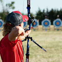 A Georgia 4-H'er participates in an archery event at the National 4-H Shooting Sports Championships in Grand Island, Nebraska.