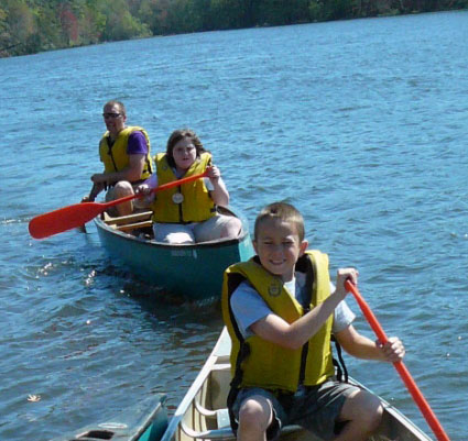 A group of students enjoys canoeing on the lake at Rock Eagle 4-H Center in Eatonton, Ga.