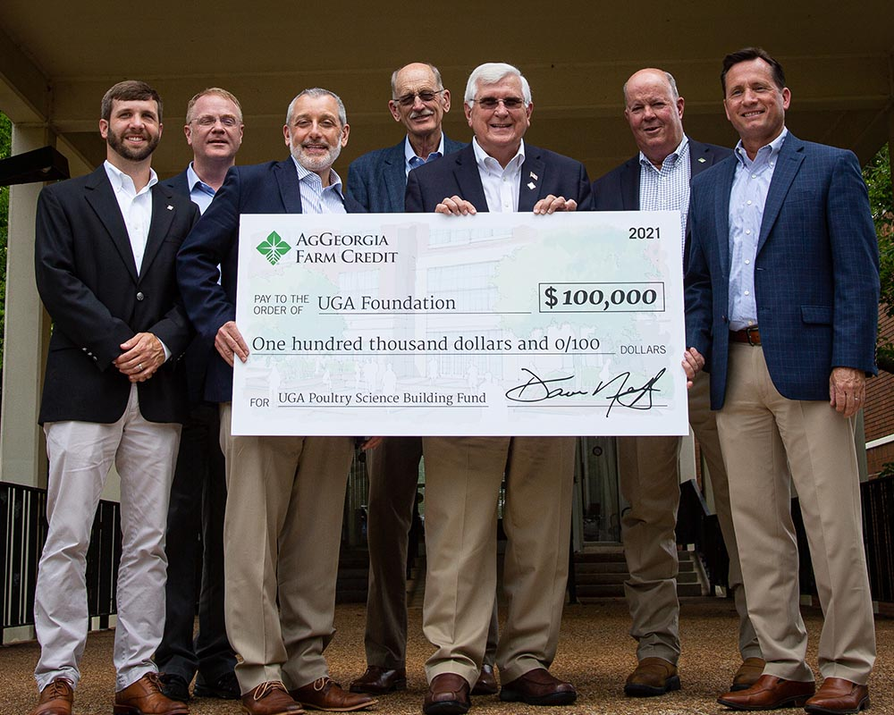 From left, AgGeorgia chief marketing officer Corey Cottle, poultry science department head Todd Applegate, CAES Dean Nick Place, AgGeorgia board member Bobby Miller, AgGeorgia board Chairman Dave Neff, AgGeorgia board Vice-chairman Jack Bentley and AgGeorgia CEO Rob Crain celebrate the lender's six-figure gift to the UGA Poultry Science Building Campaign.