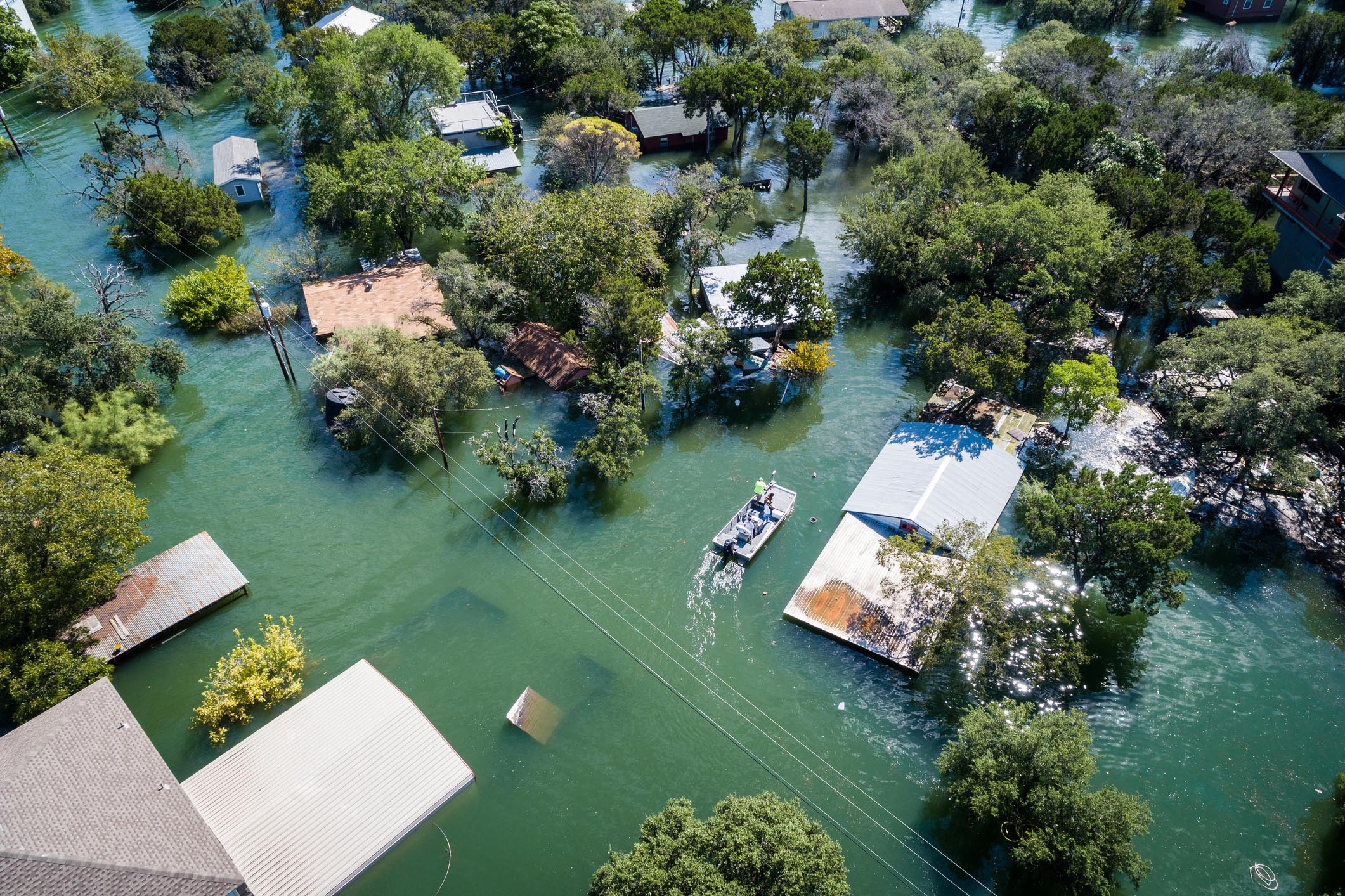 A water rescue crew searches for survivors in Texas after Hurricane Harvey, a devastating Category 4 hurricane that made landfall on Texas and Louisiana in August 2017, causing catastrophic flooding.
